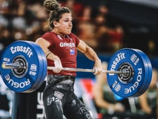 A CrossFit Athlete performs a clean (an Olympic lift) during an event at the CrossFit Games 2019.