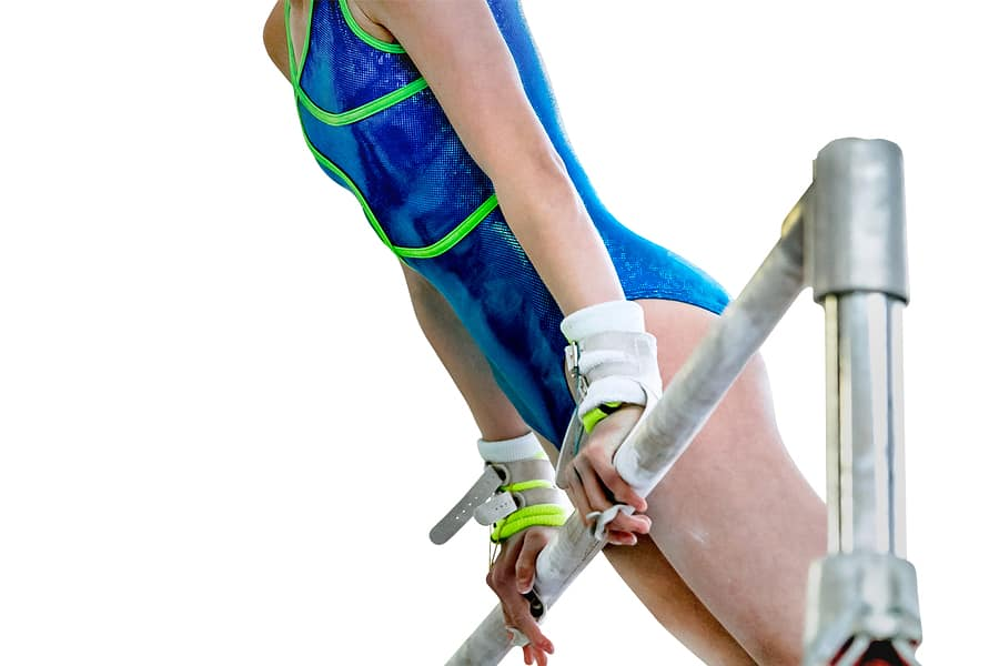 Gymnast using hand grips on the olympic uneven bars