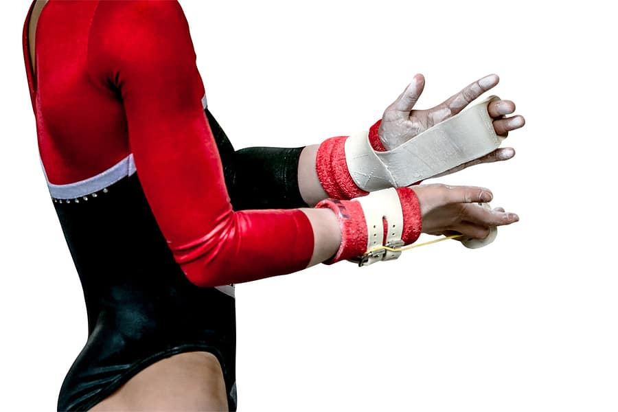 Gymnast with hand grips and chalk - a potent combination for grip safety and security.
