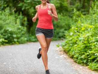 Woman in workout shorts during her running workout.