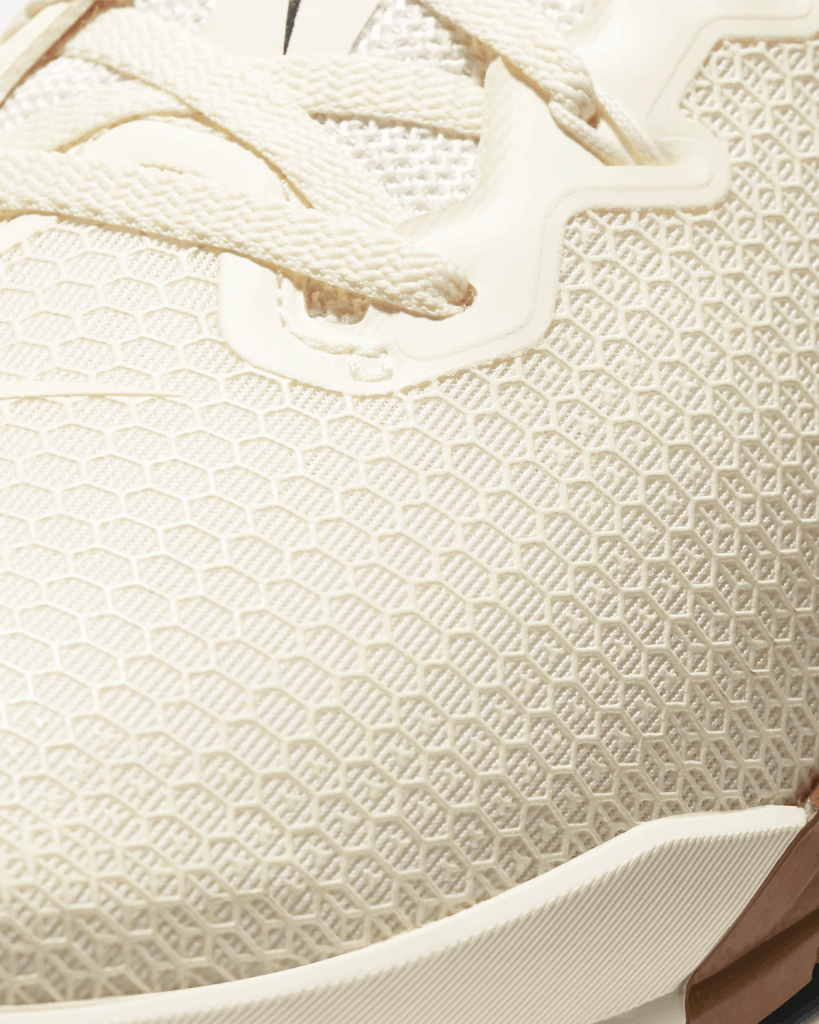 Mesh upper closeup of the Nike Metcon 5 Cross Trainer for CrossFit in Pale Ivory/Seaweed/Light British Tan/Black