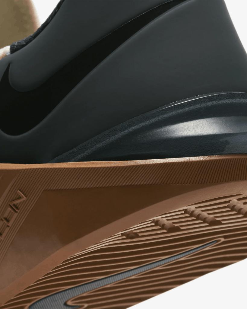 Heel closeup of the Nike Metcon 5 Cross Trainer for CrossFit in Pale Ivory/Seaweed/Light British Tan/Black