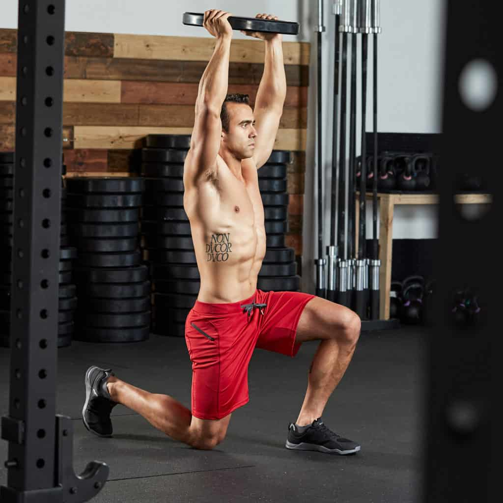 Plate lunges with the Helix II Men's Workout Short for CrossFit and HIIT - Brick