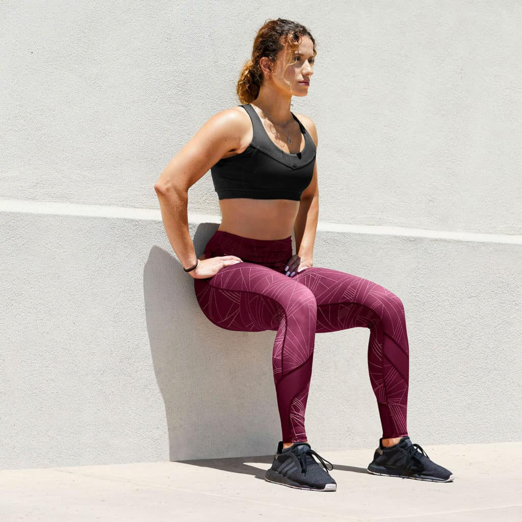 Wall squat with the Hylete Motiv II Vent Workout Tights in Galaxy Plum