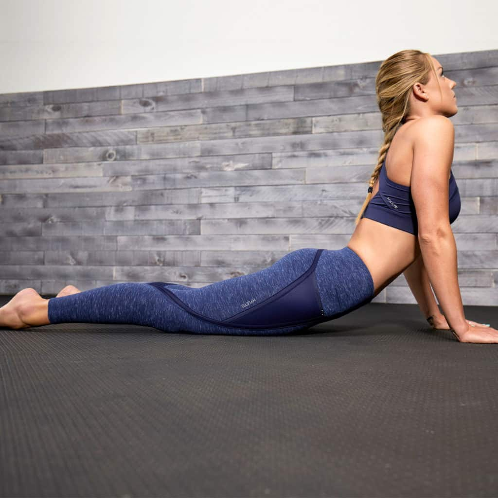 Cobra yoga pose in the Hylete Nimbus Tights for your Workout - Heather Navy/Navy