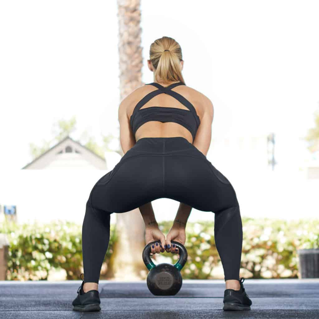 Kettlebell swing with the Nimbus Workout Tights from Hylete in Black/Black