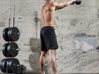 Kettlebell swing with the Hylete Vertex II men's workout shorts for the gym - black