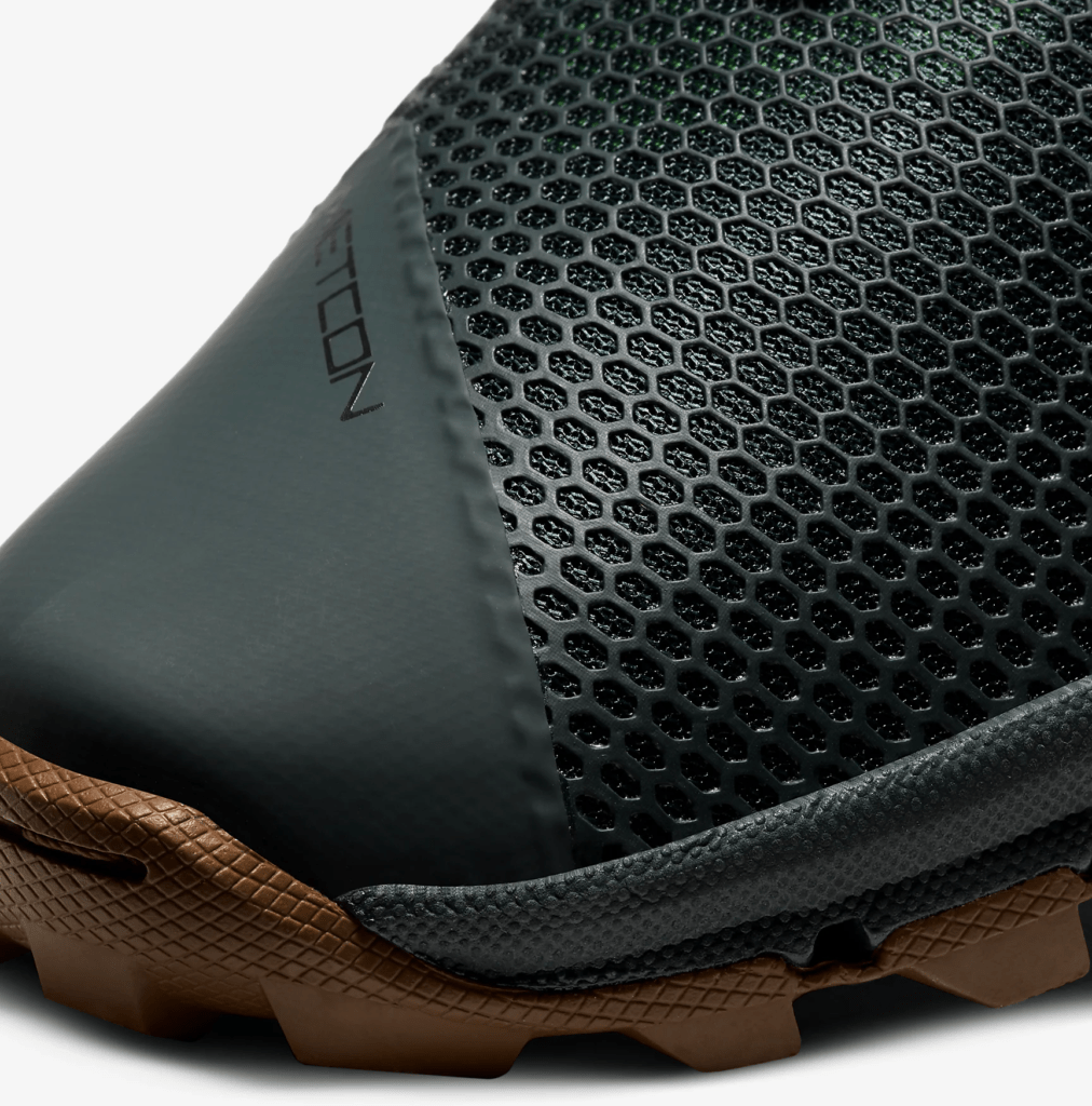 Mesh upper closeup of the Nike MetconSF shown here in Seaweed/Light British Tan/Green Spark/Black