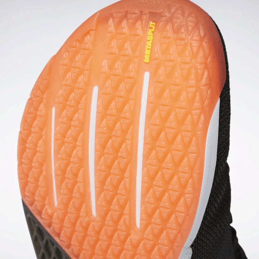sole closeup of the Reebok Nano 9 Men's CrossFit Training Shoe in Black/White/Vivid Orange