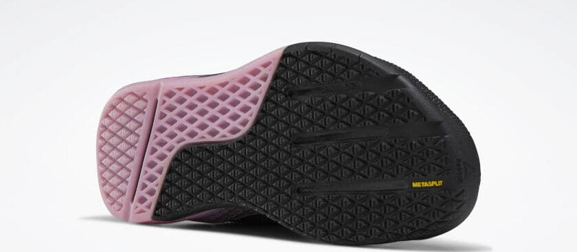 Outsole closeup of the Reebok Nano 9 Men's CrossFit Training Shoe in BLACK / COLD GREY 7 / POSH PINK