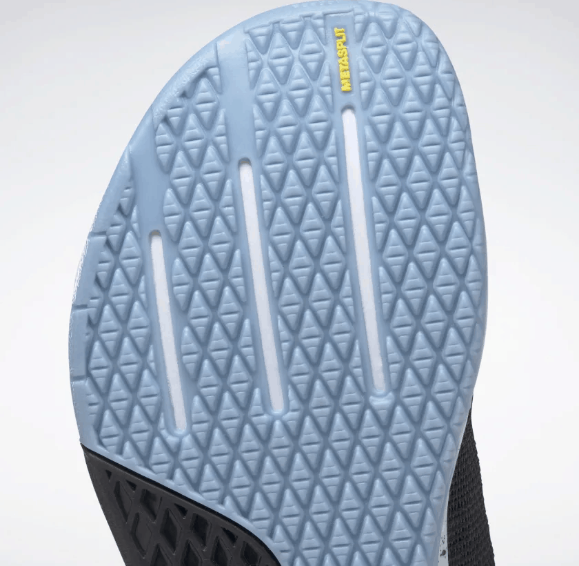 Metasplit outsole closeup of the Reebok Nano 9 Women's Training Shoe for CrossFit in Black/Fluid Blue/Lemon Glow