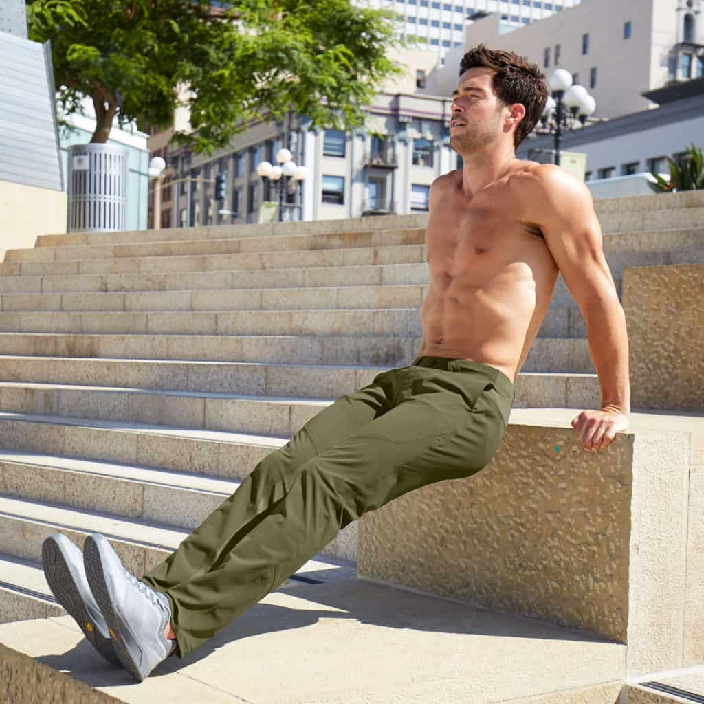 Tricep dips with the Hylete Ion Pant - CrossFit Workout Pants for Men - in Olive