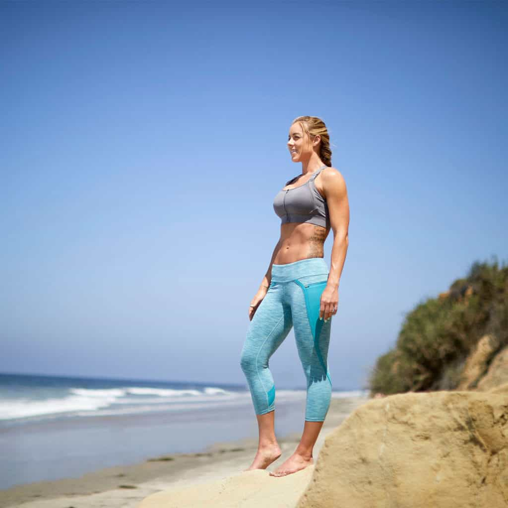 On the beach with Hylete Nimbus Capri Workout Leggings for Women - Heather Lagoon/Lagoon