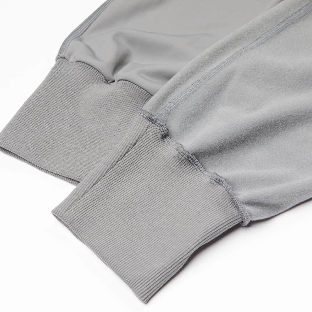 Ribbed cuffs of the Hylete Urban Jogger Workout Sweatpants for Women in Cool Gray