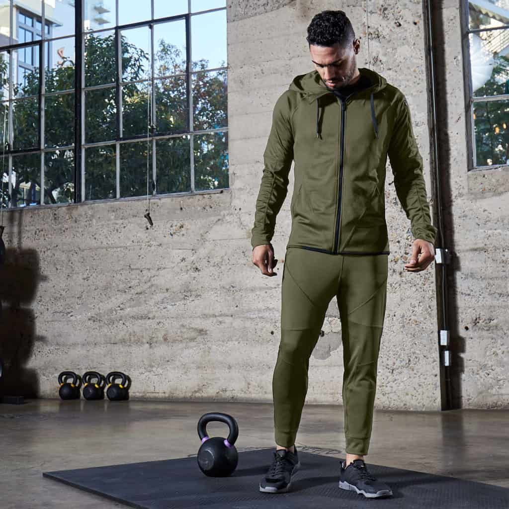 In the gym with Hylete Flexion Workout Pants for Men in Heather Olive