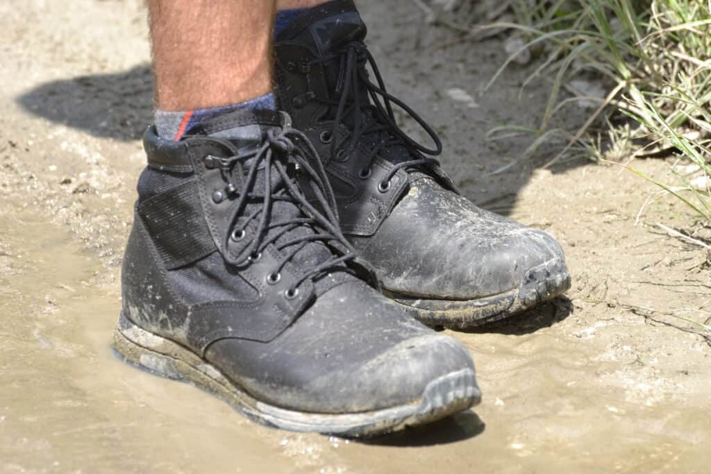 MACV-1 Black Jungle Rucking Boot on a muddy trail