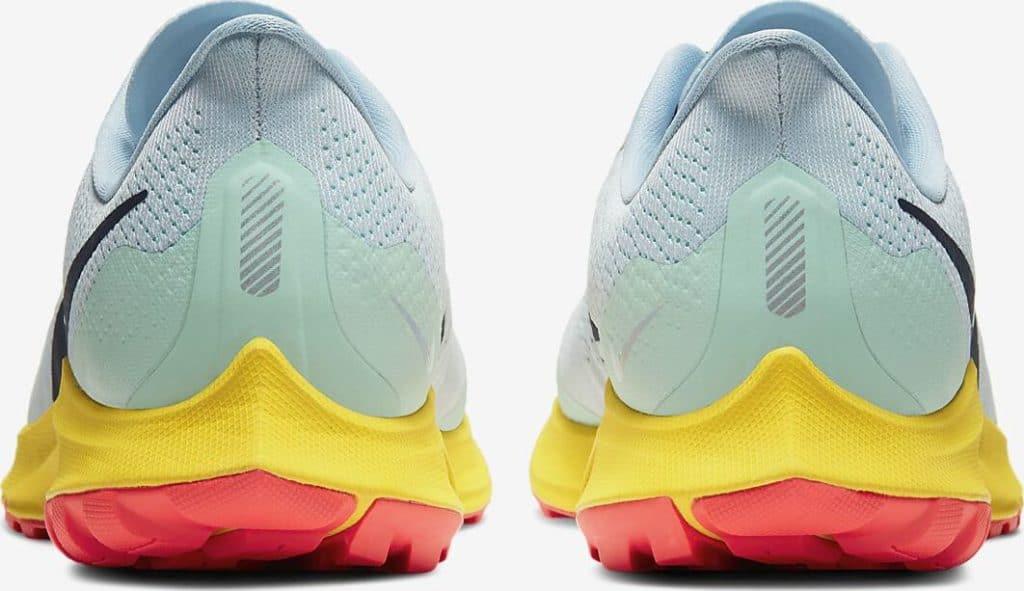 Heel view of the Nike Air Zoom Pegasus 36 Trail Running Shoe in Aura/Light Armory Blue/Mint Foam/Blackened Blue