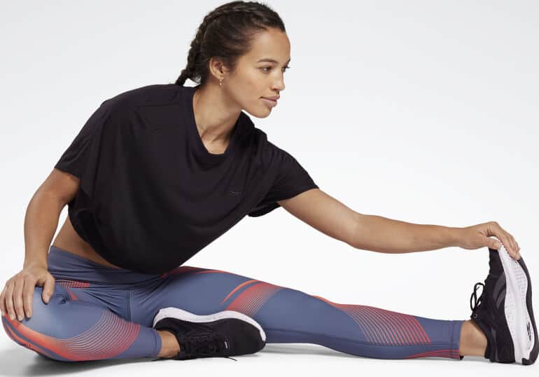 Reebok Lux Bold 2 High-Rise Leggings stretching