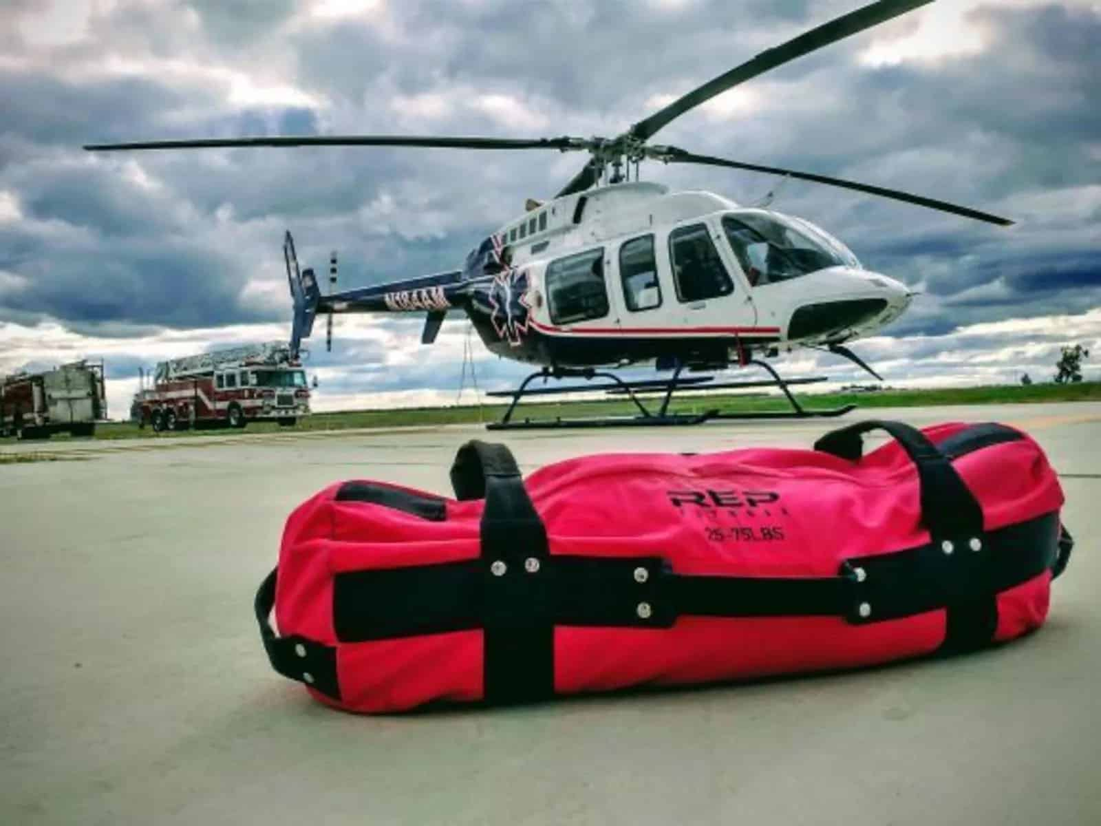 Rep Fitness V2 Sandbags pink with helicopter