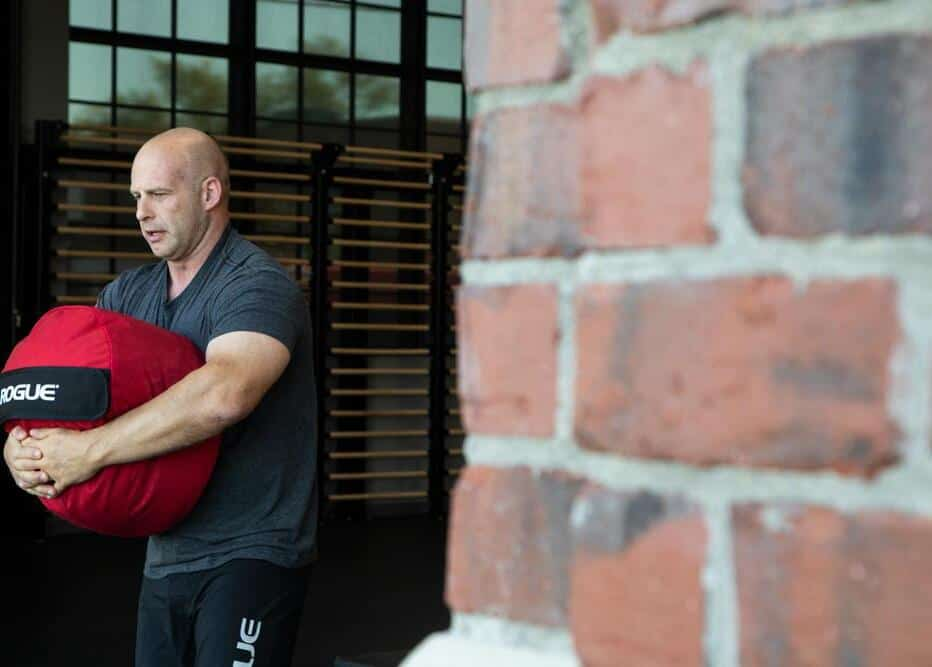 Rogue Color Strongman Sandbags red carried