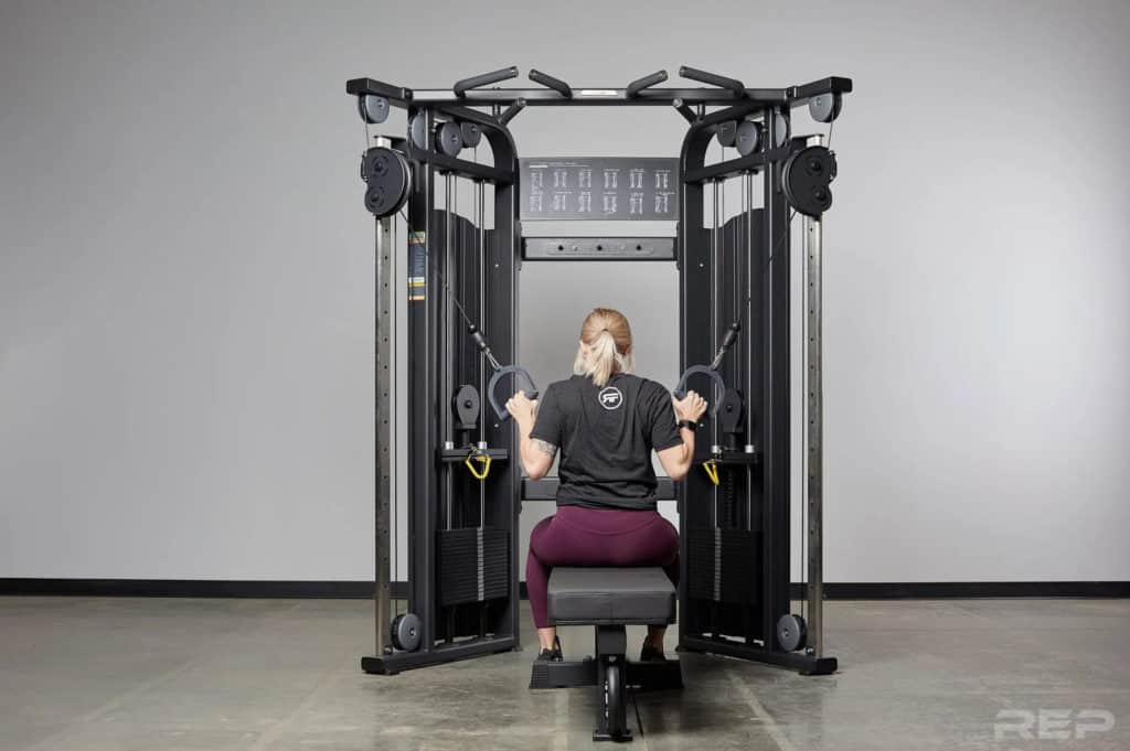 Rep Fitness REP FT-5000 Functional Trainer with a user 1