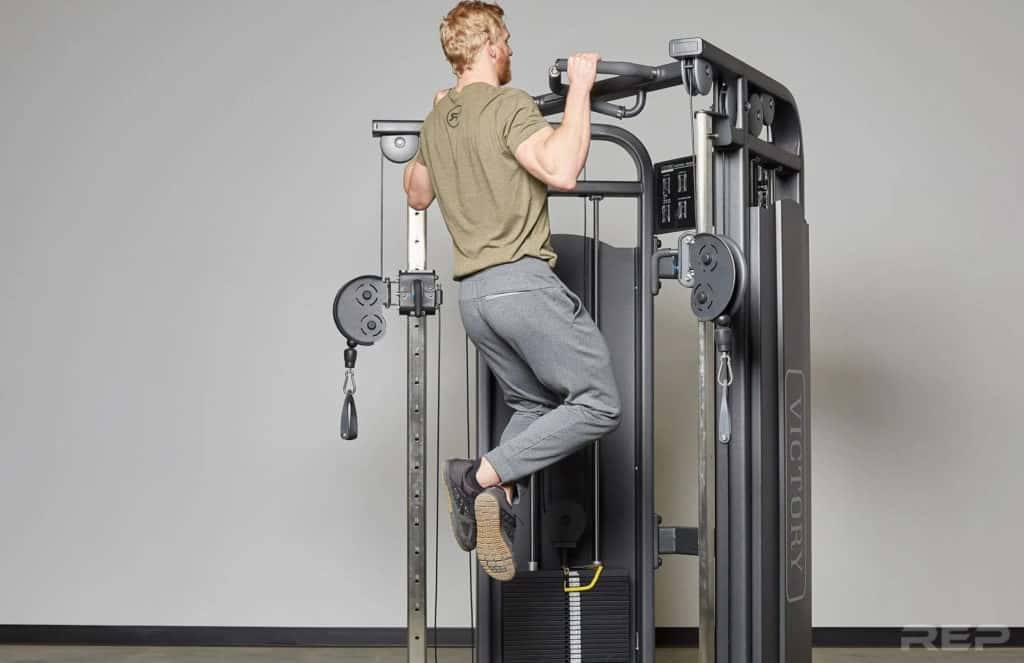Rep Fitness REP FT-5000 Functional Trainer with a user 2