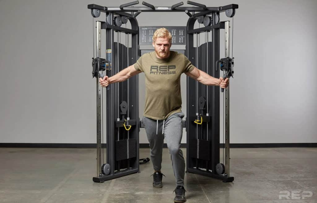 Rep Fitness REP FT-5000 Functional Trainer with a user