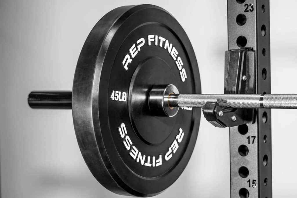 Rep Fitness Rep Black Bumper Plates on rack