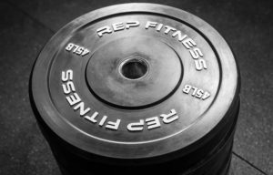 Rep Fitness Rep Black Bumper Plates stacked
