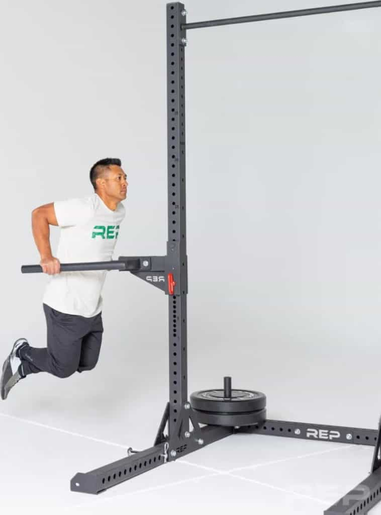 Rep Fitness SR- 4000 Squat Rack with a user 1