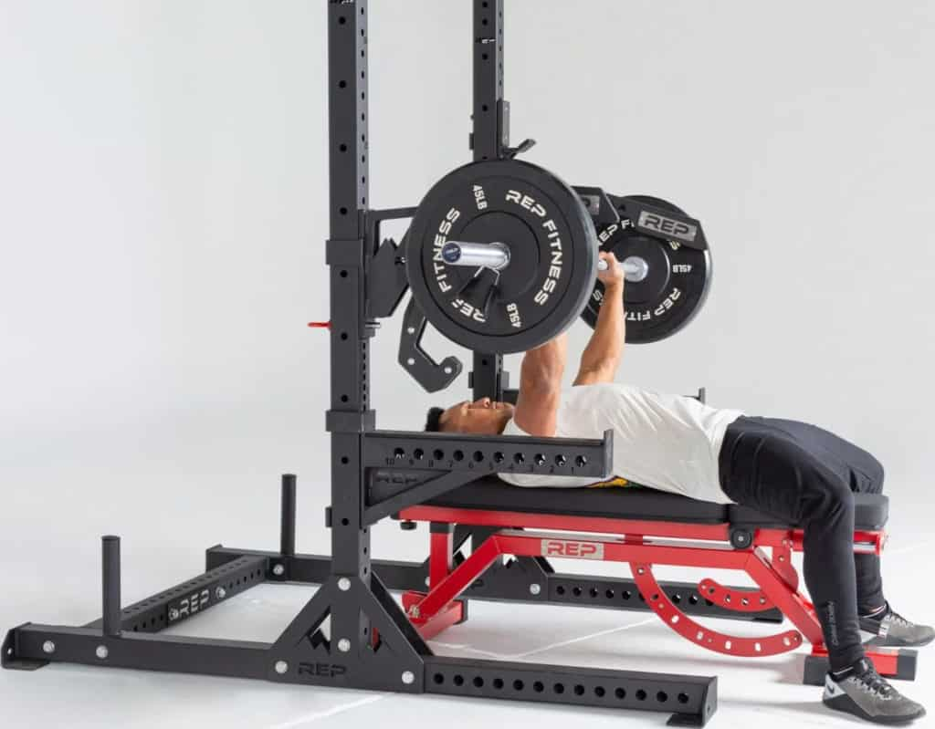 Rep Fitness SR- 4000 Squat Rack with a user 6