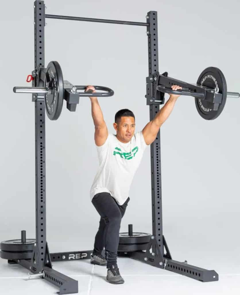 Rep Fitness SR- 4000 Squat Rack with a user