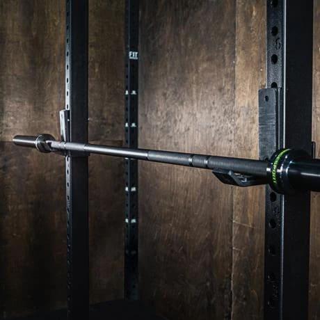 Fringe Sport Bomba Barbell V3 - Black 20kg Mens full view with a rack