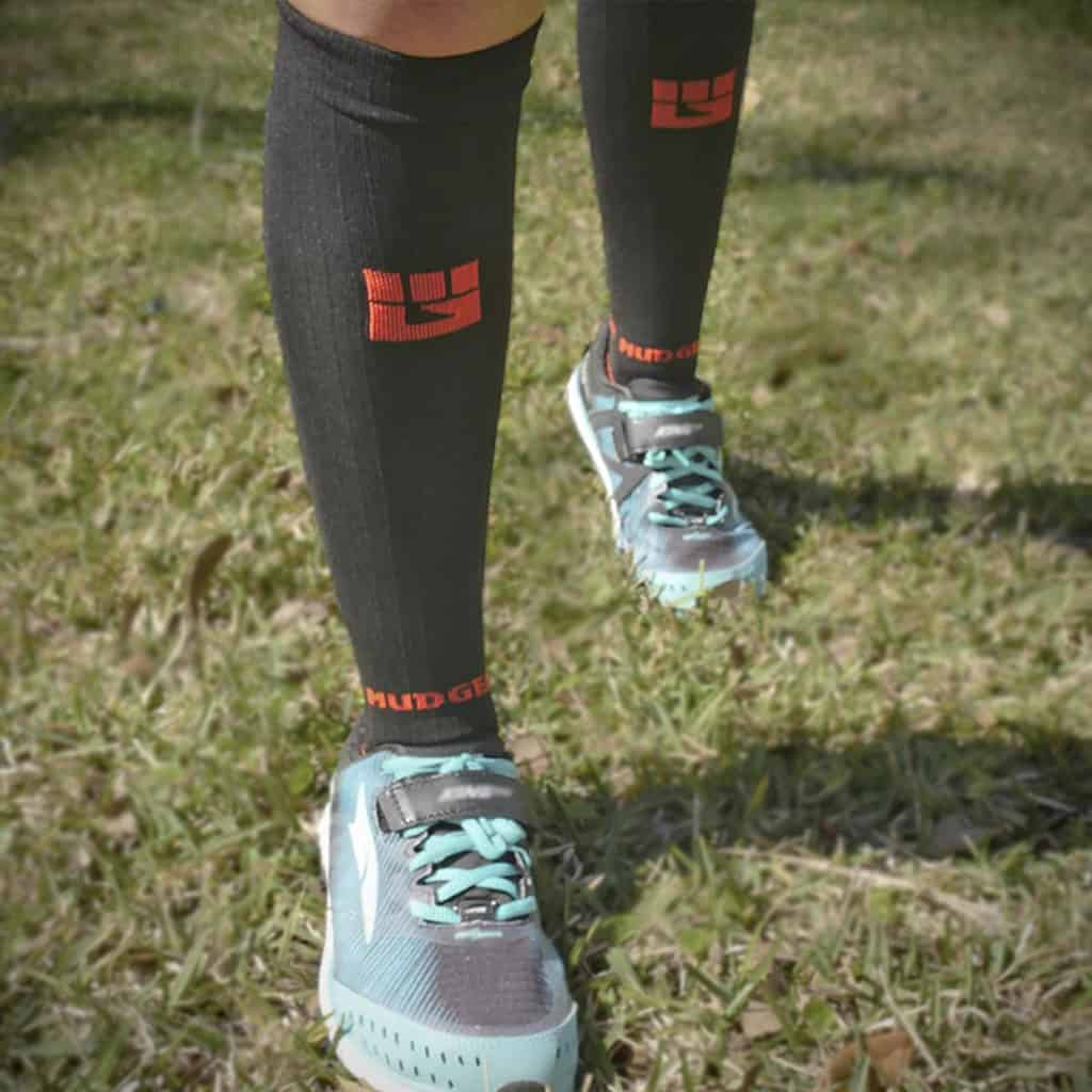 MudGear Tall Compression Socks Black Orange worn