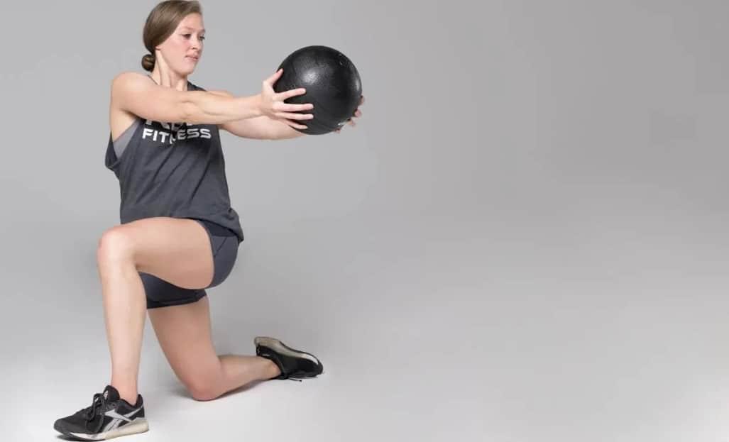 Rep Fitness V2 Slam Balls lunge woman