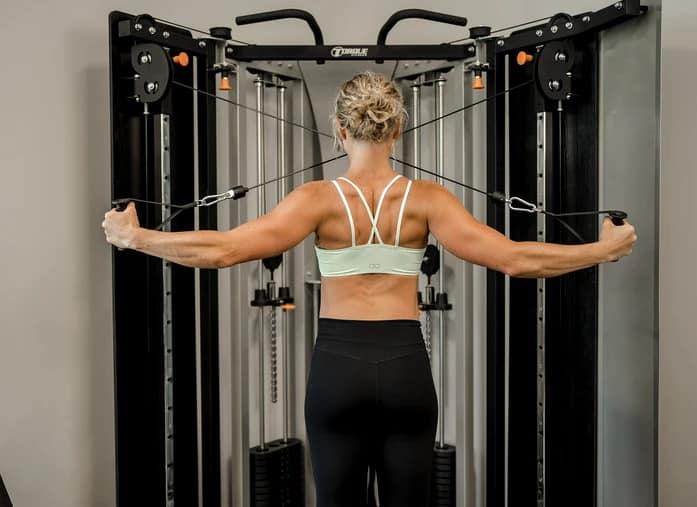 Torque Fitness F9 Fold-Away Functional Trainer with a user