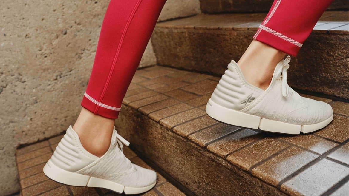 Reebok DailyFit DMX Womens Shoes climbing the stairs
