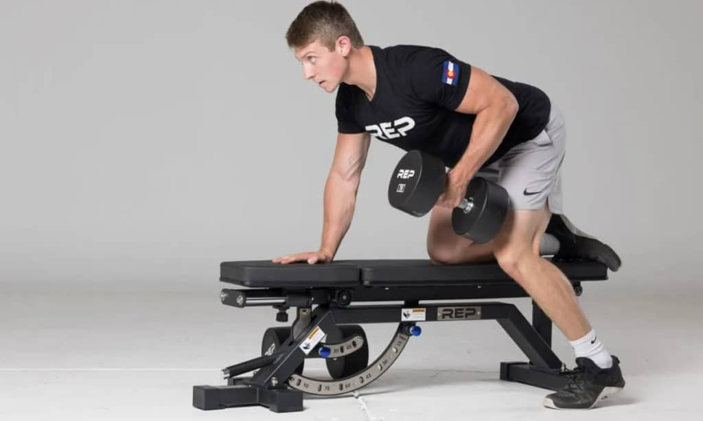 Rep Fitness AB-5000 Zero Gap Adjustable Bench Matte Black with a user