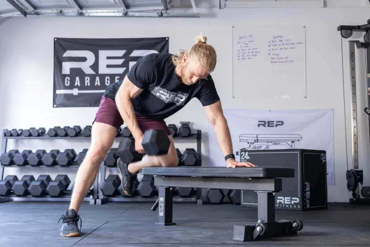 Rep Fitness FB-4000 Comp Lite Bench with a user 3