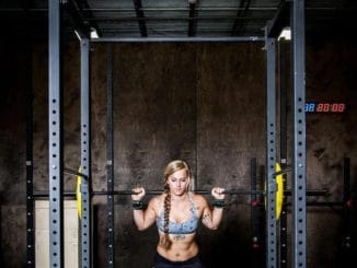 Fringe Sport Power Cage Squat Rack (Kip Cage) with a user 1